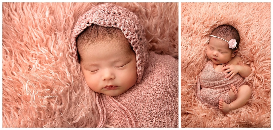 newborn baby girl in pink wrap
