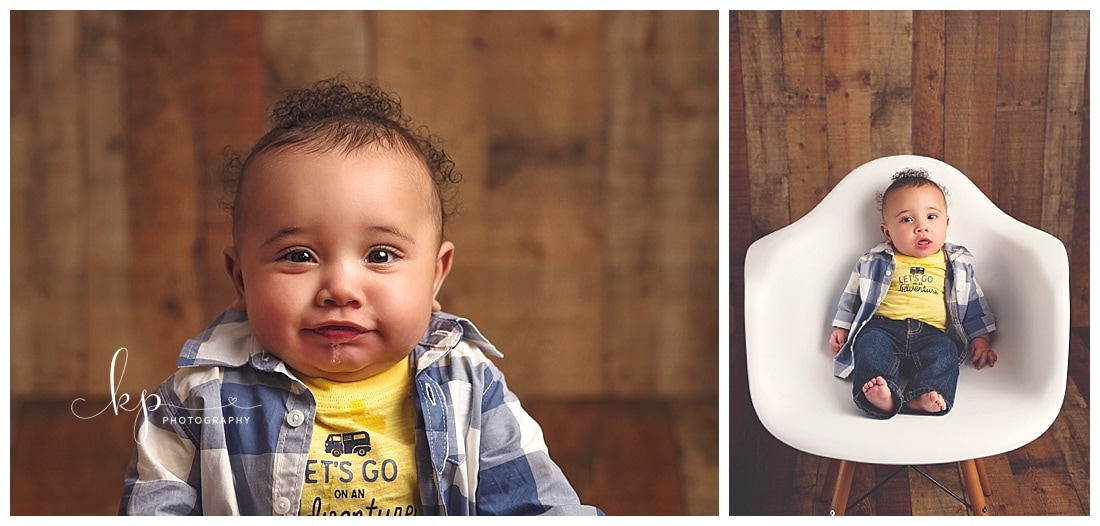 6 month old boy sitting on white chair on wood floor